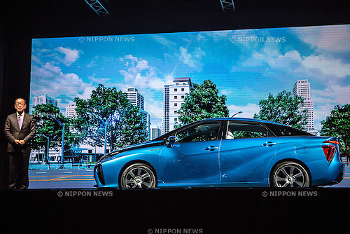 """November 18, 2014, Tokyo, Japan - Deputy Chief Engineer of Toyota Motor Corporation Yoshikazu Tanaka unveils the company's new fuel cell vehicle (FCV) named """"Mirai"""" (future) during a ceremony in central Tokyo on Tuesday, November 18, 2014. (Photo by AFLO)"""