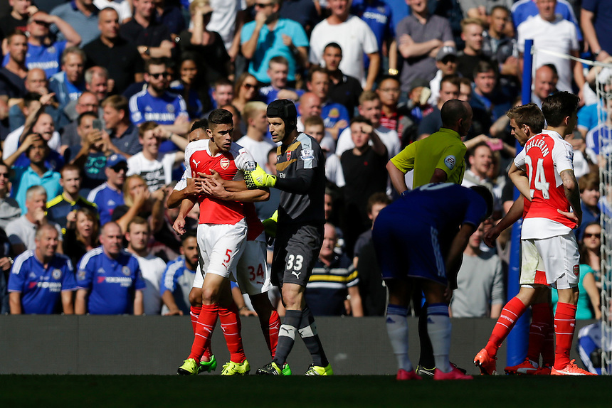 Arsenal's Gabriel Paulista has to be held back by team-mates after a flare up with Chelsea's Diego Costa (not pictured)<br /> <br /> Photographer Craig Mercer/CameraSport<br /> <br /> Football - Barclays Premiership - Chelsea v Arsenal - Saturday 19th September 2015 - Stamford Bridge - London<br /> <br /> &copy; CameraSport - 43 Linden Ave. Countesthorpe. Leicester. England. LE8 5PG - Tel: +44 (0) 116 277 4147 - admin@camerasport.com - www.camerasport.com