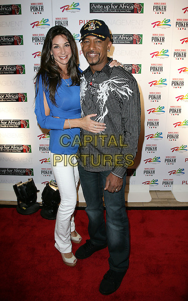 TARA & MONTEL WILLIAMS.The Ante Up for Africa Celebrity Poker Tournament at the Rio Resort Hotel and Casino, Las Vegas, Nevada, USA..July 2nd, 2009.full length white black jeans denim hat baseball cap.CAP/ADM/MJT.© MJT/AdMedia/Capital Pictures.