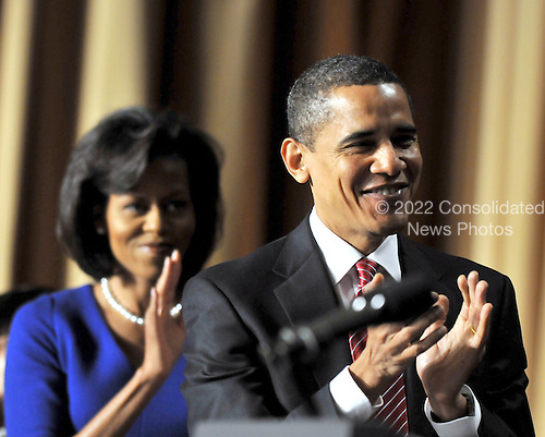Washington, D.C. - February 5, 2009 -- United States President Barack Obama and first lady Michelle Obama applaud the remarks of former Prime Minister Tony Blair of the United Kingdom at the National Prayer Breakfast in Washington, D.C. on Thursday, February 5, 2009..Credit: Ron Sachs / Pool via CNP