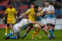 24th November 2019; AJ Bell Stadium, Salford, Lancashire, England; European Champions Cup Rugby, Sale Sharks versus La Rochelle; Romain Sazy of La Rochelle is tackled by Ben Curry of Sale Sharks - Editorial Use