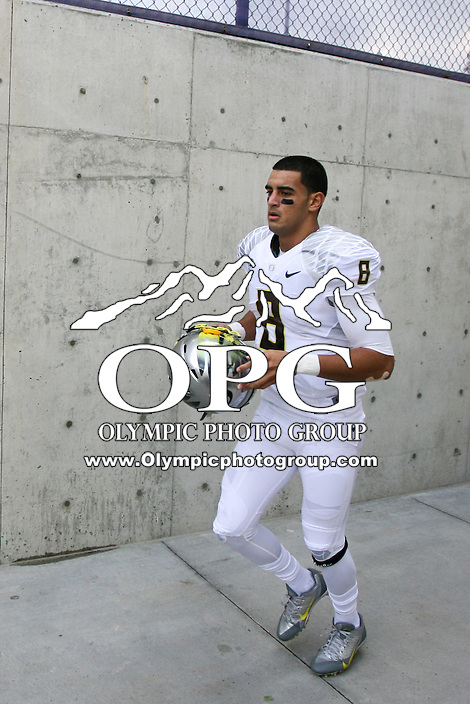 2013-10-12: Oregon's Marcus Mariota runs out from the visitors locker room after halftime against Washington.  Oregon won 45-24 over Washington in Seattle, WA.