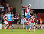 Ethan Ebanks-Landell of Sheffield Utd heads clear during the English League One match at Glanford Park Stadium, Scunthorpe. Picture date: September 24th, 2016. Pic Simon Bellis/Sportimage