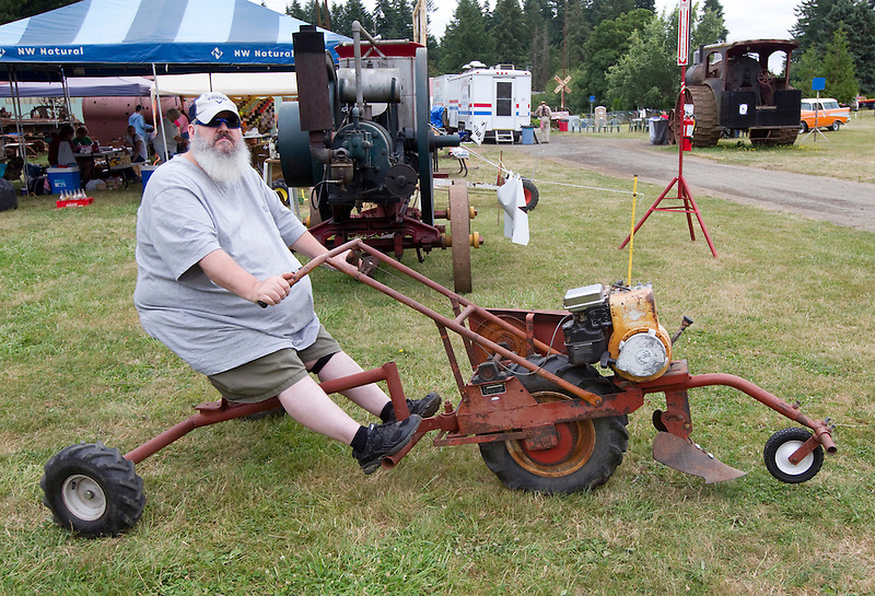 Zane Hokanson rides an old plow at the Rural Heritage Fair in Ridgefield, Sunday July 20, 2014.  The event hosted by the Fort Vancouver Antique Equipment Association, showcases the tools used in Clark County during the 19th and 20th centuries. (Natalie Behring/for the Columbian)