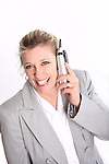 A woman talking on a cordless phone