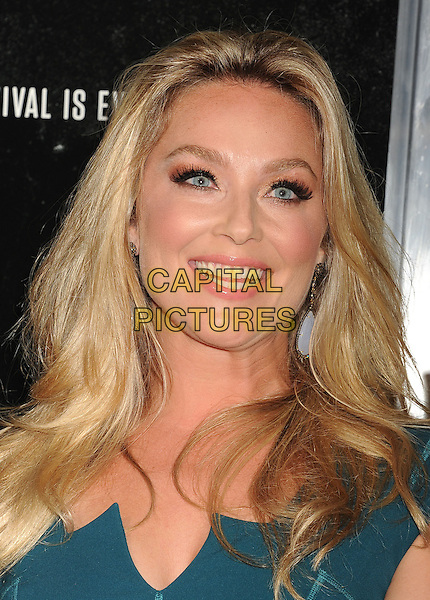 Elisabeth Rohm<br /> Premiere of &quot;Captain Phillips&quot; held at the Academy of Motion Picture Arts and Sciences, Beverly Hills, California, USA.<br /> September 30th, 2013<br /> headshot portrait green<br /> CAP/ROT/TM<br /> &copy;Tony Michaels/Roth Stock/Capital Pictures