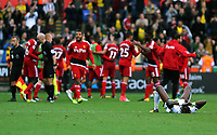 Goal scorer Tammy Abraham of Swansea City sits dejected on the pitch while Watford players celebrate their win in the background during the Premier League match between Swansea City and Watford at The Liberty Stadium, Swansea, Wales, UK. Saturday 23 September 2017