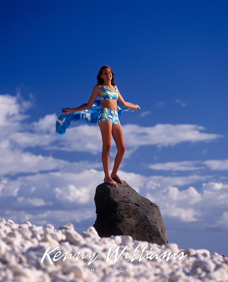 Girl Swimsuit Model, Kaena Point, Oahu, Hawaii, USA.