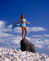 Girl Swimsuit Model, Kaena Point, Oahu, Hawaii, USA.
