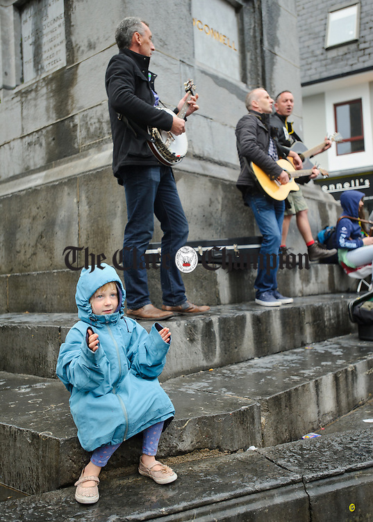 Little Zoe Seran of Wales enjoying the music of RU4Reel who were playing at O Connell square at Fleadh Cheoil na hEireann in Ennis. Photograph by John Kelly.