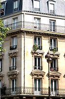 Apartment block in Paris with high windows. Paris, France.