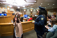 NWA Democrat-Gazette/BEN GOFF @NWABENGOFF<br /> Denia Calix, playing the bailiff, swears in Peggy Shippen, played by Leah Hamer, as she takes the witness stand in the trial of Shippen's husband Benedict Arnold Wednesday, March 7, 2018, as 5th grade students from Frank Tillery Elementary in Rogers hold a mock trial at Rogers District Court. The students put on costumes and portrayed historical figures from the American Revolution, putting Benedict Arnold on trial for treason and Capt. Thomas Preston on trial for murder in the Boston Massacre.