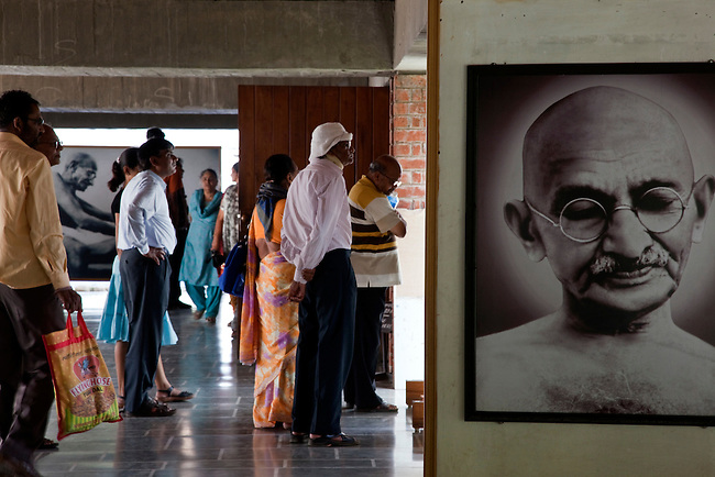 26 March 2010, Ahmedabad,Gujurat, India: Visitors walk around Sabarmati Ashram (also known as Gandhi Ashram, Harijan Ashram, or Satyagraha Ashram) is located in the Sabarmati suburb of Ahmedabad, Gujarat, adjoining the Ashram Road, on the banks of the River Sabarmati, four miles from the town hall. This was one of the residences of Mohandas Karamchand Gandhi, generally called Mahatma Gandhi, who lived there for about twelve years along with his wife, Kasturba Gandhi. Picture by Graham Crouch