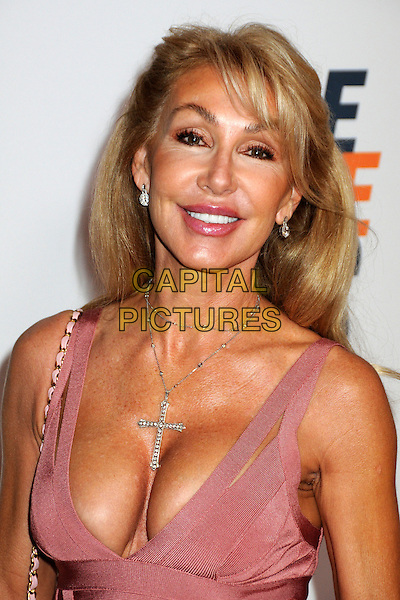 LINDA THOMPSON.17th Annual Race To Erase MS held at the Hyatt Regency Century Plaza Hotel, Century City, California, USA..May 7th, 2010.headshot portrait pink cleavage necklace cross crucifix .CAP/ADM/BP.©Byron Purvis/AdMedia/Capital Pictures.
