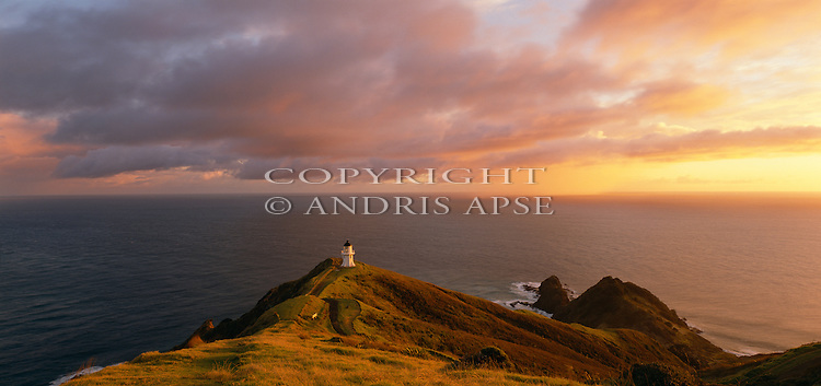 Sunrise at Cape Reinga Lighthouse. Northland Region. New Zealand.