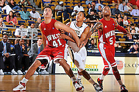 28 January 2012:  FIU guard Cameron Bell (10) battles WKU guard-forward Vinny Zollo (41) and guard Derrick Gordon (5) for position on a rebound in the second half as the Western Kentucky University Hilltoppers defeated the FIU Golden Panthers, 61-51, at the U.S. Century Bank Arena in Miami, Florida.