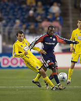 Columbus Crew defender Jed Zayner (24) and New England Revolution forward Kheli Dube (11) at midfield. The Columbus Crew defeated the New England Revolution, 1-0, at Gillette Stadium on October 10, 2009.