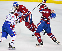 April 28, 2007; Hamilton, ON, CAN; Hamilton Bulldogs centre (31) Mikhail Grabovski high sticks Rochester Americans defenceman (3) Jeremy Swanson in game six of the AHL north division semifinal at Copps Coliseum. The Bulldogs defeated won 6-2 and eliminated the Americans from the playoffs. Mandatory Credit: Ron Scheffler, Special to the Spectator. (File number RRSA7742).