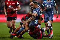 25th July 2020, Christchurch, New Zealand;  Ngani Laumape of the Hurricanesis tackled by Whetukamokamo Douglas and Codie Taylor of the Crusaders during the Super Rugby Aotearoa, Crusaders versus Hurricanes at Orangetheory stadium, Christchurch