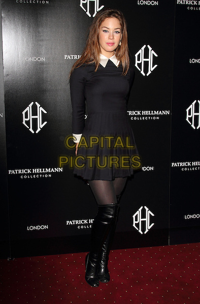 Roxanne McKee.Attending the Patrick Hellman Store Launch Party held at 50 St James, London, England, UK, March 14th 2013..full length dress pleated long sleeve knee high boots tights otk over the knee  white collar black .CAP/ROS.©Steve Ross/Capital Pictures