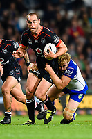 Simon Mannering of The Warriors is tackled by Aiden Tolman of the Bulldogs during the NRL Rugby League match, Bulldogs v Warriors, Forsyth Barr Stadium, Dunedin, New Zealand, 17th March 2017. Copyright photo: John Davidson / www.photosport.nz