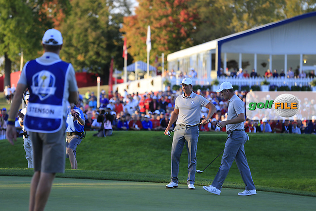 Henrik Stenson &amp; Justin Rose (Team Europe) on the 17th green during Saturday afternoon Fourball at the Ryder Cup, Hazeltine National Golf Club, Chaska, Minnesota, USA.  02/10/2016<br /> Picture: Golffile | Fran Caffrey<br /> <br /> <br /> All photo usage must carry mandatory copyright credit (&copy; Golffile | Fran Caffrey)