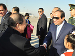 Egypt's President Abdel-Fattah Al-Sisi is welcomed upon his arrival in Beijing, China, December 22, 2014. Al-Sisi is scheduled to meet Chinese President Xi Jinping and other officials to discuss a number of political and economic topics, during a two-day official visit, in an effort to attract more Chinese investments to Egypt. Photo by Egyptian Presidency