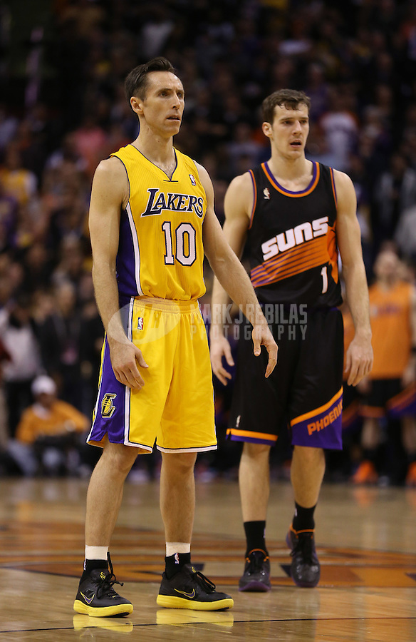 Jan. 30, 2013; Phoenix, AZ, USA: Los Angeles Lakers guard Steve Nash (10) and Phoenix Suns guard Goran Dragic (1) at the US Airways Center. Mandatory Credit: Mark J. Rebilas-