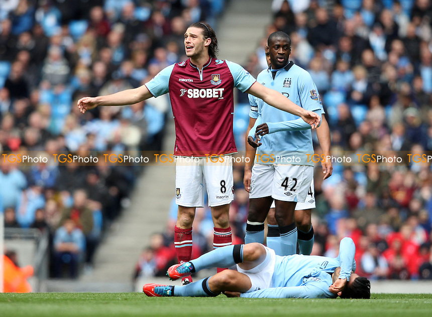 Andy Carroll of West Ham receives a yellow card for a foul on Sergio Aguero of Man City - Manchester City vs West Ham United, Barclays Premier League at the Etihad Stadium, Manchester - 27/04/13 - MANDATORY CREDIT: Rob Newell/TGSPHOTO - Self billing applies where appropriate - 0845 094 6026 - contact@tgsphoto.co.uk - NO UNPAID USE.