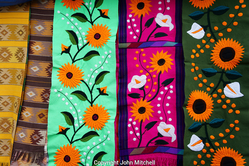 Colorful table runners in Mercado 28 souvenirs and handicrafts market in  Cancun, Mexico      .