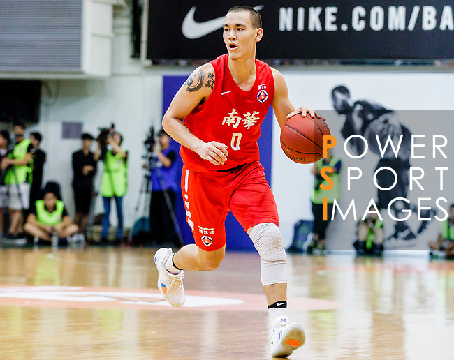 Glen Tang Robertson #00 of SCAA Men's Basketball Team dribbles the ball up court against the Winling during the Hong Kong Basketball League game between SCAA vs Winling at Southorn Stadium on June 19, 2018 in Hong Kong. Photo by Yu Chun Christopher Wong / Power Sport Images