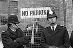 Grunwick Strike North London UK. John Gorst MP Conservative Hendon North. Talking top policmen on duty from behind factory gates. 1977