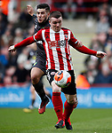 John Fleck of Sheffield Utd tussles with Emi Buendia of Norwich City during the Premier League match at Bramall Lane, Sheffield. Picture date: 7th March 2020. Picture credit should read: Simon Bellis/Sportimage