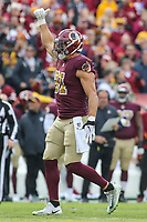Landover, MD - November 18, 2018: Washington Redskins outside linebacker Ryan Kerrigan (91) celebrates after making a sack during the  game between Houston Texans and Washington Redskins at FedEx Field in Landover, MD.   (Photo by Elliott Brown/Media Images International)