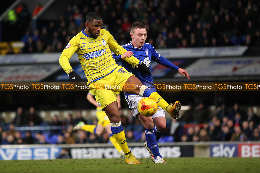 Claude Dielna of Sheffield Wednesday tangles with Freddie Sears of Ipswich Town - Ipswich Town vs Sheffield Wednesday - Sky Bet Championship Football at Portman Road, Ipswich, Suffolk  - 10/02/15 - MANDATORY CREDIT: Gavin Ellis/TGSPHOTO - Self billing applies where appropriate - contact@tgsphoto.co.uk - NO UNPAID USE