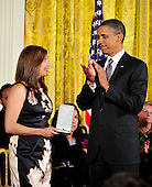 """United States President Barack Obama applauds after presenting the 2010 Citizens Medal to Susan Retik Ger of Needham, Massachusetts in the East Room of the White House in Washington, D.C. on Wednesday, August 4, 2010. In its release to the press, the White House stated """"Susan Retik Ger understands the importance of empowering women touched by personal tragedy.  After losing her husband on September 11, 2001, she found cause in educating and training Afghan widows and their children.  Her strength of spirit has healed hearts, fostering mutual understanding and brightening our common future.  Retik Ger receives the Citizens Medal for advancing women's rights and demonstrating the power of America's ideals."""" For 40 years, the Presidential Citizens Medal has recognized Americans who have """"performed exemplary deeds of service for their country or their fellow citizens."""" This Medal is among the highest honors a President can bestow, and it stands as a token of gratitude to those who represent what is best about this Nation..Credit: Ron Sachs / CNP.(RESTRICTION: NO New York or New Jersey Newspapers or newspapers within a 75 mile radius of New York City)"""