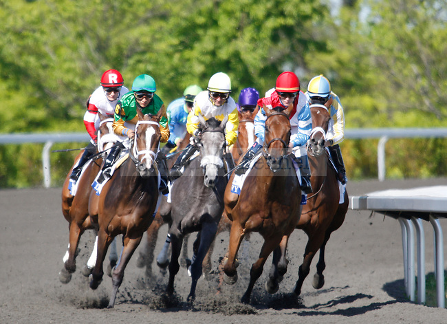 The pack rounds the first turn during the Central Bank Ashland Stakes at Keeneland Racetrack in Lexington, Ky., on Saturday, April 7, 2012. Photo by Tessa Lighty | Staff