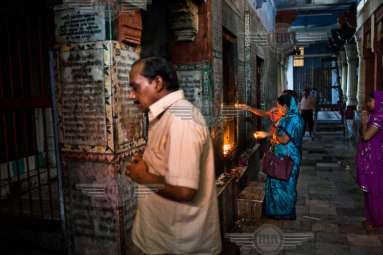 Hindu pilgrims visit and offer prayers at the Gauri Kedareshwar temple on Kedar Ghat in the ancient city of Varanasi.