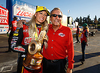 Feb 12, 2017; Pomona, CA, USA; NHRA top fuel driver Leah Pritchett (left) celebrates with team owner Don Schumacher after winning the Winternationals at Auto Club Raceway at Pomona. Mandatory Credit: Mark J. Rebilas-USA TODAY Sports