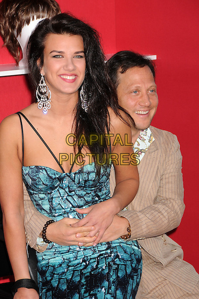 """ROB SCHNEIDER & GUEST.""""You Don't Mess With The Zohan"""" LA Premiere at Grauman's Chinese Theatre, Hollywood, California, USA..May 28th, 2008.half length cream beige pinstripe suit blue pattern dress sitting arms around waist .CAP/ADM/BP.©Byron Purvis/AdMedia/Capital Pictures."""