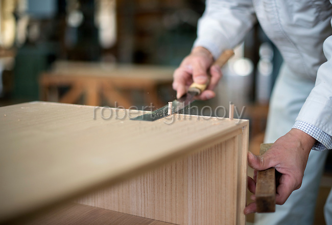 Takashi Fujita, 51, works on kiri-tansu furniture at Kamo Kiri-tansu maker Asakura Kagu in Niigata City, Niigata Prefecture Japan on Feb. 21, 2017. ROB GILHOOLY PHOTO