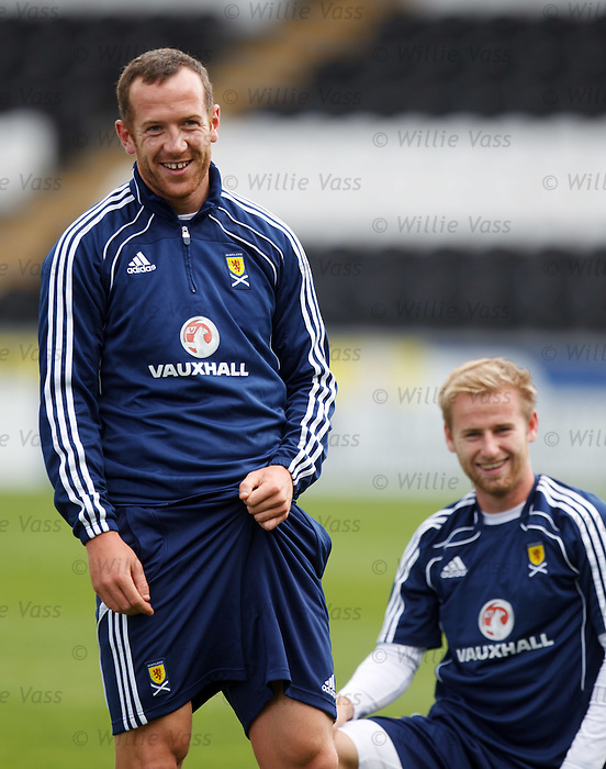 Charlie Adam laughs after getting his revenge on Barry Bannan
