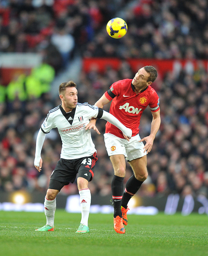 Manchester United's Nemanja Vidic battles with Fulham's Muamer Tankovic<br /> <br /> Photo by Dave Howarth/CameraSport<br /> <br /> Football - Barclays Premiership - Manchester United v Fulham - Sunday 9th February 2014 - Old Trafford - Manchester<br /> <br /> &copy; CameraSport - 43 Linden Ave. Countesthorpe. Leicester. England. LE8 5PG - Tel: +44 (0) 116 277 4147 - admin@camerasport.com - www.camerasport.com