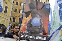 Roma, 23 Ottobre 2012.Montecitorio.Lavoratori del comparto sicurezza e vigili del fuoco manifestano davanti il Parlamento contro la legge di stabilità 2013.Sui cartelli un fotomontaggio