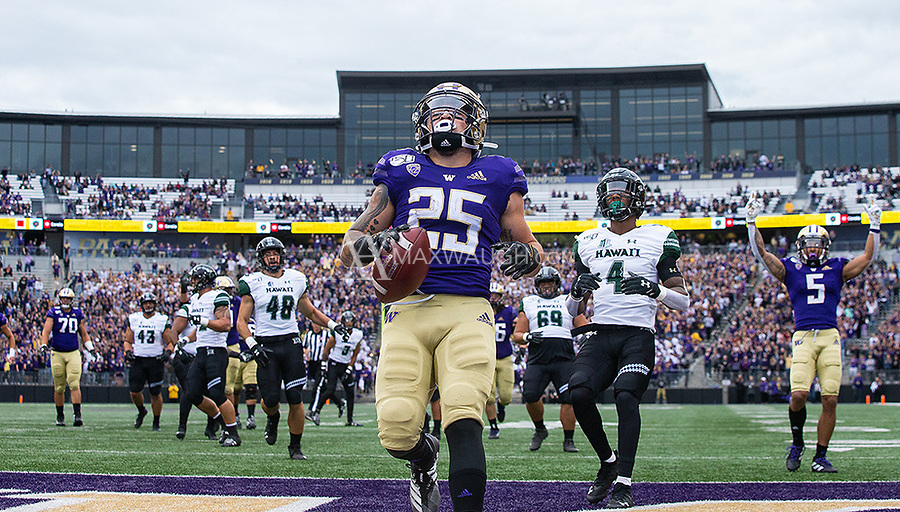 Sean McGrew enters the end zone after a 22-yard run.
