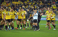 Referee Jonathan Kaplan signals fulltime during the Super 15 rugby match between the Hurricanes and Chiefs at Westpac Stadium, Wellington, New Zealand on Friday, 13 July 2012. Photo: Dave Lintott / lintottphoto.co.nz