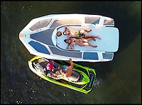 BNPS.co.uk (01202 558833)<br /> Pic: Sealver/BNPS<br /> <br /> The jet-ski slot can be turned into a sundeck.<br /> <br /> Is it a boat - Is it a jetski....It's both!<br /> <br /> A futuristic-looking boat that is solely powered by a jetski has hit the market and it could be yours for less than &pound;8,000.<br /> <br /> The Sealver Wave Boat 444 works by allowing most mainstream jetskis to connect to the rear end, both powering and steering the boat. The jetski can then be detached at your leisure with the 14.5ft long vessel left anchored in the sea. <br /> <br /> The process of attaching and detaching the ski is quick and simple with customised adaptor kits allowing the likes of Yamaha, Kawasaki and Sea-Doo to hook up easily. <br /> <br /> Depending on the jetski powering it, the 617.2lb Wave Boat can reach speeds of 50 knots - the equivalent of 57mph.