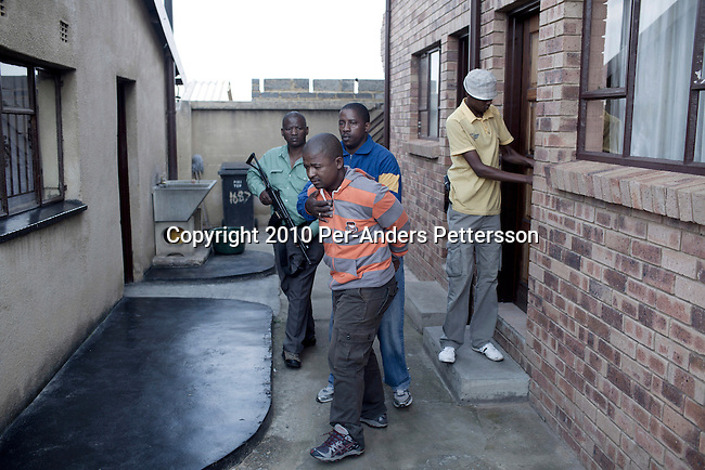 SOWETO, SOUTH AFRICA - MAY 2: A special police force unit makes an arrest of a robbery suspect on May 2, 2010, in the Orlando section of Soweto, South Africa. Soweto is the largest township in South Africa, located about 10 kilometers southwest of downtown Johannesburg. The population is estimated to be around 2-3 million. A growing black middle class can be seen in the township and many shopping malls and has been built the last few years. (Photo by Per-Anders Pettersson)