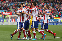 Players Atletico Madrid celebrating goal of Tiago