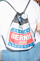 A woman wears a Bernie Sanders campaign backpack at the Iowa State Fair in Des, Moines, Iowa, on Sun., Aug. 11, 2019.